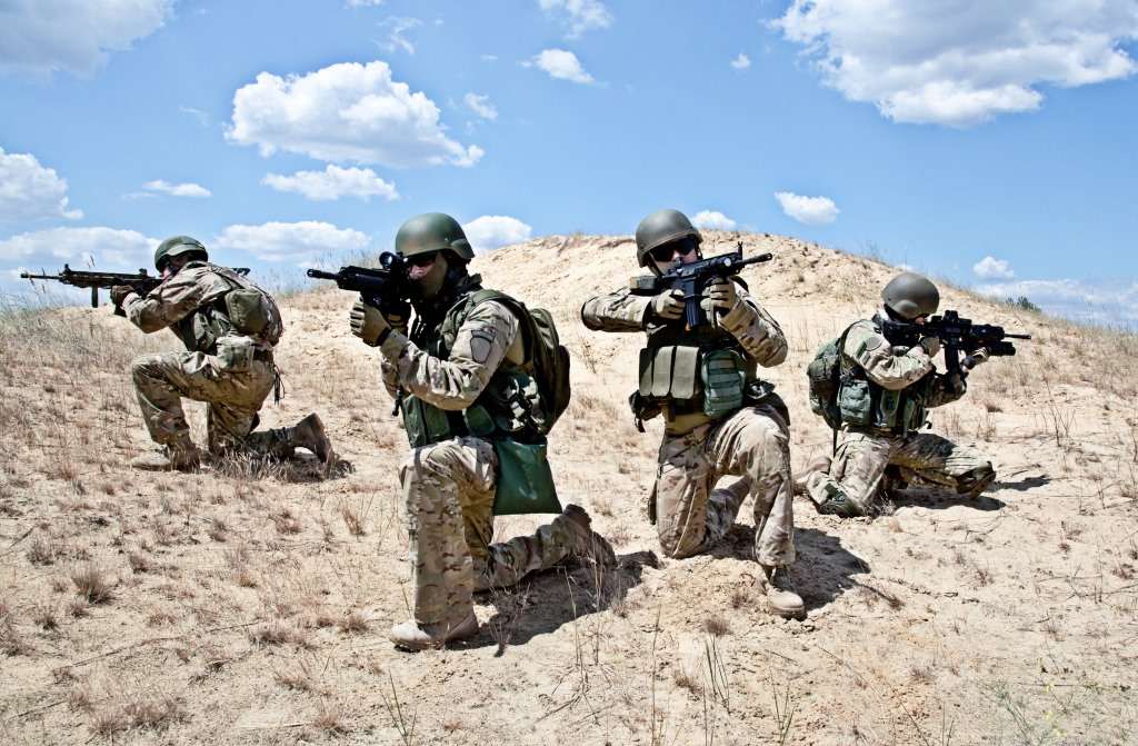 Squad of soldiers in the desert during the military operation