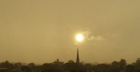 Setting sun over cathedral spire2